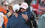 Patrick, left, and Jeannie Watts, center, are consoled by neighors at their Pleasant Valley home, south of Reno, Nev., on Saturday, Jan. 21, 2012. Their home was one of 29 destroyed by a wind-driven brush fire that raced through the area on Thursday, killing Jeannie's mother June Hargis, 93. (AP Photo/Cathleen Allison)
