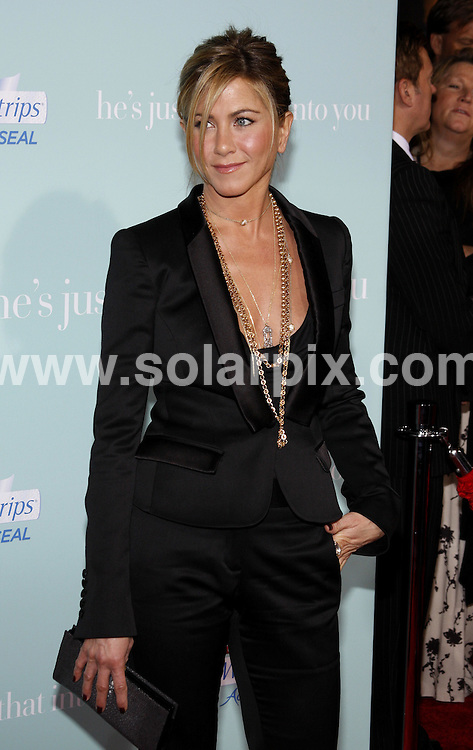 "**ALL ROUND PICTURES FROM SOLARPIX.COM**.**SYNDICATION RIGHTS FOR UK, AUSTRALIA, DENMARK, PORTUGAL, S. AFRICA, SPAIN & DUBAI (U.A.E) ONLY**.arrivals for the world premiere of ""He's Just Not That Into You"". Held at the Grauman's Chinese Theater, Hollywood, California, USA. 2 February 2009..This pic: Jennifer Aniston..JOB REF: 8387 PHZ (Gabber)  DATE: 02_02_2009 .**MUST CREDIT SOLARPIX.COM OR DOUBLE FEE WILL BE CHARGED* *ONLINE USAGE FEE £50.00 PER PICTURE - NOTIFICATION OF USAGE TO PHOTO@SOLARPIX.COM*"
