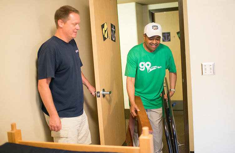 Ohio University President Roderick McDavis (Right) helps Warren Holland move his daughter Kati Holland into her new room in Lincoln Hall. Photo by Ben Siegel/ Ohio University