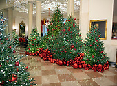 "The 2018 White House Christmas decorations, with the theme ""American Treasures"" which were personally selected by first lady Melania Trump, are previewed for the press in Washington, DC on Monday, November 26, 2018. These decorations are along the cross-hall in the Grand Foyer.  <br /> Credit: Ron Sachs / CNP"