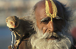 A Sadhu with a mongoose, it was estimated that over 100,000 Sadhus and holy men attended the Maha Kumbha Mela in 1989.Maha Kumbha Mela is held every twelve years at Prayag (Allahabad) in Uttar Pradesh in India.