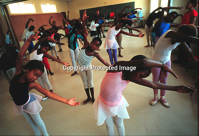 didance00028 .Dance. Young ballet students are training in a class room at Yomelela school in Khayelitsha, South Africa..©Per-Anders Pettersson/iAfrika Photos