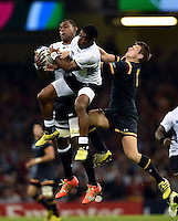 Leone Nakarawa and Aseli Tikoirotuma of Fiji compete with Dan Biggar of Wales for the ball in the air. Rugby World Cup Pool A match between Wales and Fiji on October 1, 2015 at the Millennium Stadium in Cardiff, Wales. Photo by: Patrick Khachfe / Onside Images