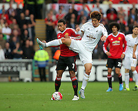 Pictured L-R: Memphis Depay of Manchester United is challenged by Ki Sung Yueng of Swansea Sunday 30 August 2015<br /> Re: Premier League, Swansea v Manchester United at the Liberty Stadium, Swansea, UK
