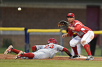 Batavia Muckdogs first baseman Carlos Duran (25) takes a pickoff attempt as Brenton Allen (23) dives back during a game against the Auburn Doubledays on June 16, 2014 at Dwyer Stadium in Batavia, New York.  Batavia defeated Auburn 4-3.  (Mike Janes/Four Seam Images)