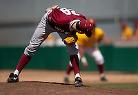 LOS ANGELES, CA - April 10, 2011: Danny Sandbrink of Stanford baseball looks to the runner on first during Stanford's game against USC at Dedeaux Field in Los Angeles. Stanford lost 6-2.