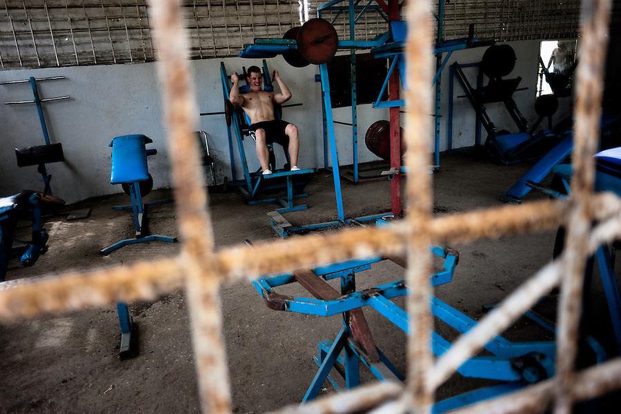 A young Cuban man trains at a bodybuilding gym in Alamar, a public housing complex in the Eastern Havana, Cuba, 9 February 2011.