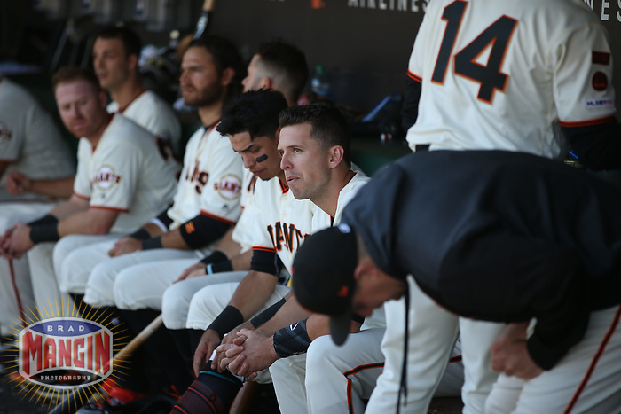 SAN FRANCISCO, CA - SEPTEMBER 15:  Buster Posey #28 of the San Francisco Giants sits in the dugout during the game against the Miami Marlins at Oracle Park on Sunday, September 15, 2019 in San Francisco, California. (Photo by Brad Mangin)