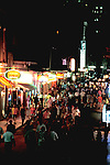 Louisiana, New Orleans: Bourbon Street at nightl.  Photo #: lanewo103.  Photo copyright Lee Foster, www.fostertravel.com, 510/549-2202,  lee@fostertravel.com
