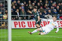 Sergio Aguero of Manchester City shoots under pressure from Alfie Mawson of Swansea City during the EPL - Premier League match between Swansea City and Manchester City at the Liberty Stadium, Swansea, Wales on 13 December 2017. Photo by Mark  Hawkins / PRiME Media Images.