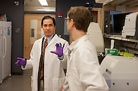Dr. Dan Barouch speaks with researchers in his lab at the Center for Life Sciences building at Beth Israel Deaconess Medical Center in Boston, Massachusetts, USA. Pictured are Dr. Dan Barouch (left), Peter Abbink (right, virology manager), Dr. James Whitney (not pictured, co-author and Instructor in Medicine at Beth Israel Deaconess Medical Center and Harvard Medical School), and Dr. Rafael Larocca (not picturedpost-doctoral fellow).<br /> <br /> Dr. Dan Barouch is Professor of Medicine and physician at Beth Israel Deaconess Medical Center and Harvard Medical School in Boston, Massachusetts, USA. He is director of the Barouch Lab at the Center for Virology and Vaccine Research at Beth Israel Deaconess Medical Center and has recently published research on the evaluation of novel antibody therapy for HIV infection.<br /> <br /> CREDIT: M. Scott Brauer for the Wall Street Journal<br /> AIDS