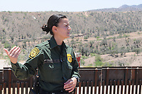 Nogales, Arizona - U.S. Customs Border Protection (CBP) Public Affairs Officer Crystal Amarillas talks to journalists in an area next to the U.S.-Mexico border fence, in Nogales, Arizona. National and international reporters participated in a two-day event organized by the Border Patrol. The Nogales station is one of eight in the Tucson Sector, which is the busiest on the U.S.-Mexico border for illegal immigration, drug smuggling and border deaths. It is also the largest station of the Border Patrol's 139 stations, and it covers 32 linear miles of the U.S.-Mexico border and a total area of 1,100 square miles. Photo by Eduardo Barraza © 2012