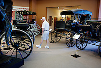 Visitors look at old carriages on display at the Old West Museum in Cheyenne, Wyoming, Thursday, June 2, 2011.  The museum celebrates Frontier Days which occurs at the end of July...Photo by Matt Nager