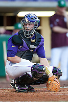 LSU Tigers catcher Ty Ross #26 looks into the dugout for a sign against the Mississippi State Bulldogs during the NCAA baseball game on March 17, 2012 at Alex Box Stadium in Baton Rouge, Louisiana. The 10th-ranked LSU Tigers beat #21 Mississippi State, 4-3. (Andrew Woolley / Four Seam Images).