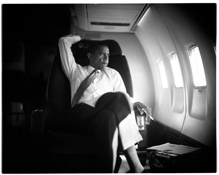 ©2008 David Burnett.Contact Press Images.Oct 17  2008.Senator Barack Obama, Democratic nominee for President, on his charter campaign airplane, heading to St. Louis, MO for a rally.  At the Rally, with 100000 people in attendance.