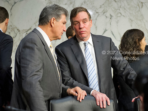 United States Senators Joe Minchin (Democrat of West Virginia), left, and Mark Warner (Democrat of Virginia), right, in conversation prior to the US Select Committee on Intelligence conducting an open hearing titled &quot;Worldwide Threats&quot; on Capitol Hill in Washington, DC on Thursday, May 11, 2017.  <br /> Credit: Ron Sachs / CNP<br /> (RESTRICTION: NO New York or New Jersey Newspapers or newspapers within a 75 mile radius of New York City)