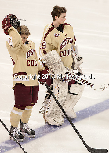 Emily Pfalzer (BC - 14), Corinne Boyles (BC - 29) - The Boston College Eagles defeated the visiting Harvard University Crimson 3-1 in their NCAA quarterfinal matchup on Saturday, March 16, 2013, at Kelley Rink in Conte Forum in Chestnut Hill, Massachusetts.