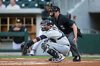 Columbus Clippers catcher Guillermo Quiroz (29) sets a target as home plate umpire John Bacon looks over his shoulder during the game against the Charlotte Knights at BB&T BallPark on May 3, 2016 in Charlotte, North Carolina.  The Clippers defeated the Knights 8-3.  (Brian Westerholt/Four Seam Images)