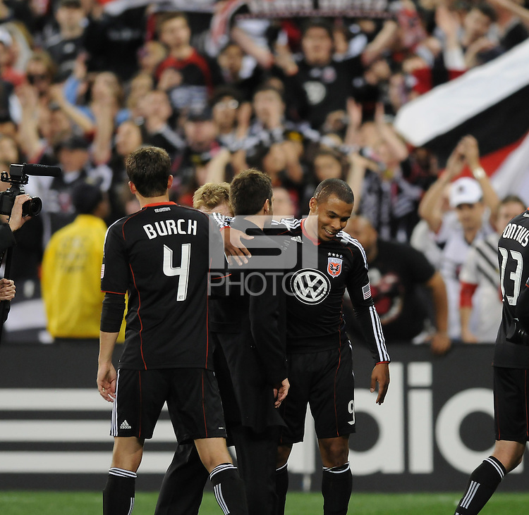 DC United forward Charlie Davies (9) celebrates the victory with Head Coach Ben Olsen at the end of the game.  DC United defeated The Columbus Crew 3-1  at the home season opener, at RFK Stadium, Saturday March 19, 2011.