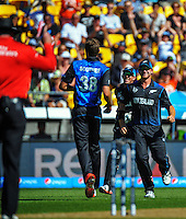 Luke Ronchi and Corey Anderson congratulate Tim Southee on his dismissal of Jos Buttler during the ICC Cricket World Cup one day pool match between the New Zealand Black Caps and England at Wellington Regional Stadium, Wellington, New Zealand on Friday, 20 February 2015. Photo: Dave Lintott / lintottphoto.co.nz
