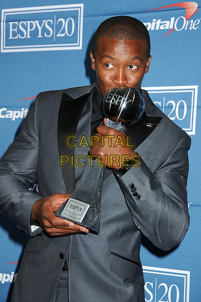 Demaryius Thomas.2012 ESPY Awards - Press Room held at Nokia Theatre L.A. Live, Los Angeles, California, USA..July 11th, 2012.half length grey gray award trophy winner  blue suit kiss kissing .CAP/ADM/BP.©Byron Purvis/AdMedia/Capital Pictures.