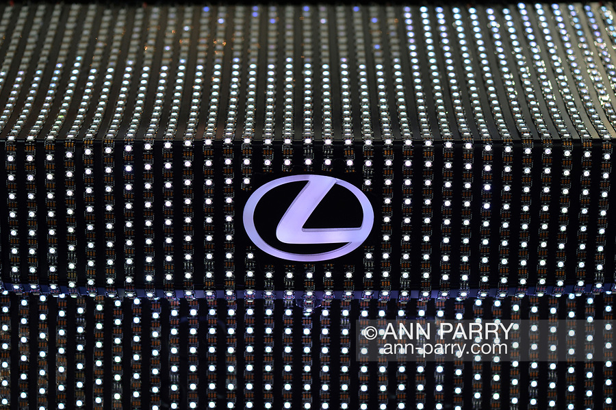 """Manhattan, New York, USA. April 12, 2017.  Closeup view of Levus logo area of trunk is shown of Lexus LIT IS 2017 sedan - covered with 41,999 tiny LED light units programmed to create changing patterns and colors - on display at the New York International Auto Show, NYIAS, at the Javits Center. The car had appeared during New York Fashion Week and is featured in UK artist Dua Lipa's music video for her song """"Be the One."""""""