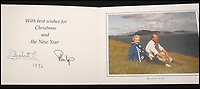 BNPS.co.uk (01202 558833)<br /> Pic: MooreAllen&amp;Innocent/BNPS<br /> <br /> The Queen and Philip sent a photograph of themselves on a blustery hill in the Western Isles as their 1996 card.<br /> <br /> A comprehensive collection of Christmas cards sent by the Queen and Prince Philip over a 30 year period have emerged to highlight the fascinating changes of the Royal Family.<br /> <br /> The 31 greetings cards carry various images of the Royal couple on the front along with different members of their family.<br /> <br /> They were sent every year without fail from 1971 through to 2001 to the unnamed recipient, who was clearly an acquaintance of the Queen.<br /> <br /> The first card features a formal photograph of the Queen, the Duke of Edinburgh, a 23-year-old Prince Charles, Princess Anne, Prince Andrew, aged 11 and seven-year-old Prince Edward.<br /> <br /> They are being sold in Cirencester on Friday.