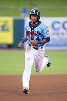 Addison Russell (4) of the Tennessee Smokies hustles towards third base against the Mississippi Braves at Smokies Park on July 22, 2014 in Kodak, Tennessee.  The Smokies defeated the Braves 8-7 in 10 innings. (Brian Westerholt/Four Seam Images)
