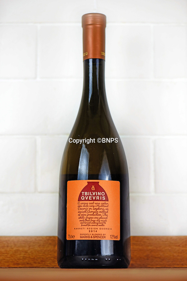 BNPS.co.uk (01202 558833)<br /> Pic: BNPS.co.uk<br /> <br /> Orange is the new pink...<br /> <br /> Forget rosé - an 'orange' wine made using an ancient technique favoured by the Romans is set to this summer's hottest tipple.<br /> <br /> The peculiar plonk - which is made from leaving grape skins in juice for a few days or weeks rather than removing it immediately - is fast becoming a favourite among wine buffs and foodies after hitting shelves in the UK.<br /> <br /> Said to have a richer, more complex flavour than regular white, orange wine uses ancient methods whereby wines were fermented naturally in clay pots with their skins on at unregulated temperatures.