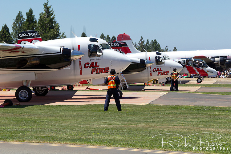 A pair of Cal Fire Turbo Trackers and an OV-10 Bronco prepare to launch at Nevada County Air Attack Base. The Turbo Tracker is a civilian conversion of the Navy's S-2 Tracker. The Calfire fleet, formerly California Department of Forestry, includes 23 of the Turbo Trackers located throughout the state. Each aircraft is capable of carrying 1200 gallons of water or retardant and able to reach a fire within 20 minutes.
