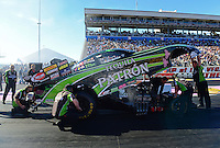 Oct. 26, 2012; Las Vegas, NV, USA: NHRA crew members for funny car driver Alexis DeJoria during qualifying for the Big O Tires Nationals at The Strip in Las Vegas. Mandatory Credit: Mark J. Rebilas-