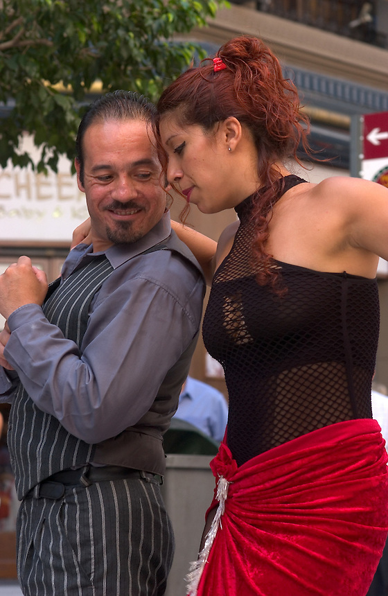 Tango performers dance on Calle Florida in downtown in Buenos Aires. Noted Argentine author Jorge Luis Borges wrote often about people on the margins in the Buenos Aires of the early 20th Century -- thugs, knife fighters, prostitutes and scoundrels who danced the tango in dangerous bars. The magic realist author influenced the work of many of the western hemisphere's greatest writers.<br /><br />(Kevin Moloney for the New York Times)
