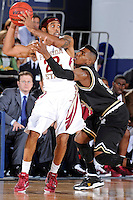 18 November 2010:  FIU's Jeremy Allen (32) defends FSU's Derwin Kitchen (22) in the second half as the Florida State University Seminoles defeated the FIU Golden Panthers, 89-66, at the U.S. Century Bank Arena in Miami, Florida.