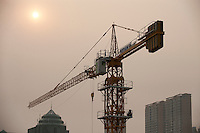 Daytime landscape view of a construction crane and commercial buildings in the Heping District in Tiānjīn.  © LAN