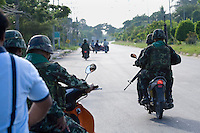 Armed soldiers at one of the many checkpoints in and around the town of Pattani. The insurgency in Southern Thailand began as a conflict between the Malay muslim population and central government, but now the boundaries have become blurred and various guerilla groups have become involved. No-one seems certain as to who is fighting who. As of March 2008, the insurgency had claimed as many as 3,000 lives.
