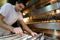 Anis Bouabsa, winner of the Best Baguette in Paris prize for 2008, prepares bread in his bakery, Au Duc de la Chapelle in the 18th arrondissement of Paris, France, 21 January 2008.