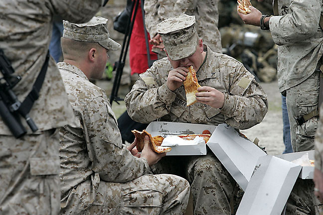 Cpl. Jerrod Nichols and Lcpl. Kristofer Katzenberger enjoy some pizza before deployment Monday. The main body of 2nd Battalion, 8th Marine Regiment, based at Camp Lejeune, N.C. will deploy to Afghanistan in support of Operation Enduring Freedom. The battalion will conduct counter-insurgency operations in partnership with Afgan National Security Forces.