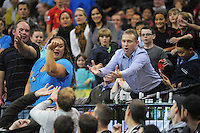 Fans try to catch the ball during the national basketball league match between Wellington Saints and Manawatu Jets at TSB Bank Arena, Wellington, New Zealand on Tuesday, 7 May 2013. Photo: Dave Lintott / lintottphoto.co.nz