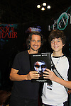 "General Hospital Michael Easton (One Life To Live, Port Charles, Days of Our Lives) poses with All My Children JQ DePaiva (son of Kassie and James) at the New York Comic Con 2012 to show fans and others ""Soul Stealer Collector's Edition"" which he cowrote and  was in a booth with Christopher Shy on October 13, 2012 at the Javits Center, New York City, New York. (Photo by Sue Coflin/Max Photos)"