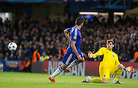 Goalkeeper Iker Casillas of FC Porto saves from Diego Costa of Chelsea but the rebound from his own players flies past him moments later during the UEFA Champions League group G match between Chelsea and FC Porto at Stamford Bridge, London, England on 9 December 2015. Photo by Andy Rowland.