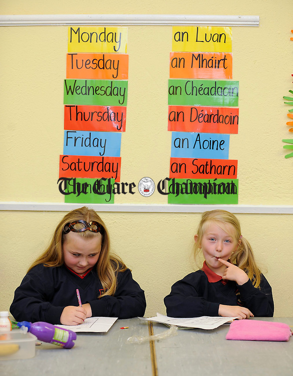 Friends Zoe O Neill and Nicole Fitzgerald in class at Meelick National School. Photograph  by John Kelly.