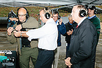 While Republican presidential candidate and South Carolina senator Lindsey Graham looks on, a television reporter fires a Sig Sauer P320 pistol during a campaign stop at Sig Sauer Academy in Epping, New Hampshire. Sig Sauer is submitting the pistol to the US government to consider as the standard military service pistol. Sig Sauer Academy is a training facility for domestic and international military and police forces.