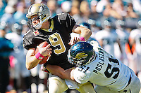 October 02, 2011:   New Orleans Saints quarterback Drew Brees (9) is sacked by Jacksonville Jaguars middle linebacker Paul Posluszny (51) during fourth quarter action between the Jacksonville Jaguars and the New Orleans Saints at EverBank Field in Jacksonville, Florida.  New Orleans defeated Jacksonville 23-10.........