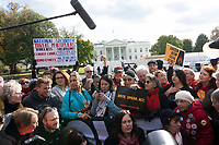 Actress and political activist Jane Fonda, joined by Ben Cohen and Jerry Greenfield of Ben and Jerry's Ice Cream, participates in a climate protest in front of the White House in Washington D.C., U.S., on Friday, November 8, 2019.  Activists marched from Capitol Hill to the White House to draw attention to the need to address climate change.  Credit: Stefani Reynolds / CNP /MediaPunch