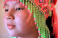 Khoua Yang dons a traditional Hmong headpiece for a cultural celebration in Duluth, MN.
