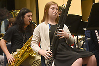 NWA Democrat-Gazette/FLIP PUTTHOFF <br /> CONCERT FINALE<br /> Thompson Rhew (left) plays saxaphone while Sarah McBride plays basoon on Saturday May 11 2019 with the Rogers High School concert band during warm-ups before the end of year concert in the school auditorium. The school's concert band and symphonic band performed during the concert. An awards banquet followed the music.