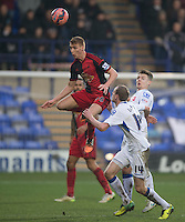 Picture by Steve Flynn/AHPIX.com, Football: The FA Cup 3rd Round match Tranmere Rovers -V- Swansea City  at Prenton Park, Birkenhead, Merseyside, England on copyright picture Howard Roe 07973 739229<br /> <br /> <br /> Swansea City's Jay Fulton heads clear under pressure from Tranmere Rovers Max Power and Marc Laird