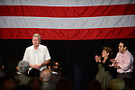 SWEETWATER, FL - MAY 18: Former Florida Governor and potential Republican presidential candidate Jeb Bush speaks to supporters as his wife, Columba Bush and son, Jeb Bush, jr. stand on stage with him during a fundraising event at the Jorge Mas Canosa Youth Center on May 18, 2015 in Sweetwater, Florida. Mr. Bush is thought to be seeking to run for the Republican nomination but he has yet to formally announce his intentions.  ( Photo by Johnny Louis / jlnphotography.com )