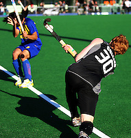 Malaysia's Mohamad Sukri Abd. Mutalib dodges a pass from Ben Collier during the international hockey match between the New Zealand Black Sticks and Malaysia at Fitzherbert Park, Palmerston North, New Zealand on Sunday, 9 August 2009. Photo: Dave Lintott / lintottphoto.co.nz