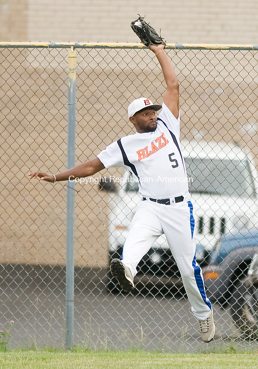 PLYMOUTH, CT-070617JS06--Watertown's Darryl Wilson (5) makes a leaping catch at the fence during their Tri-State baseball game against Terryville Thursday at the old Terryville High School. <br /> Jim Shannon Republican-American